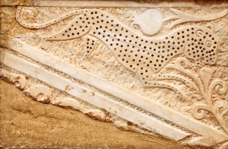 Dettaglio di pietra della scultura di bassorilievo sulla parete antica fotografia stock libera da diritti