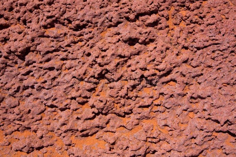 Dettaglio di pietra rosso dell'Arizona con la sabbia arancio del deserto fotografie stock