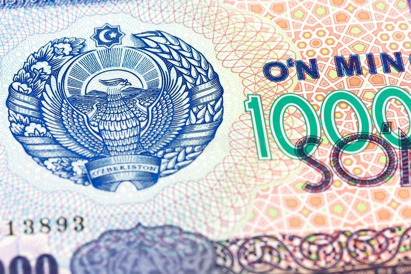 Dettaglio di un complemento della banconota del som di 10000 usbek immagini stock