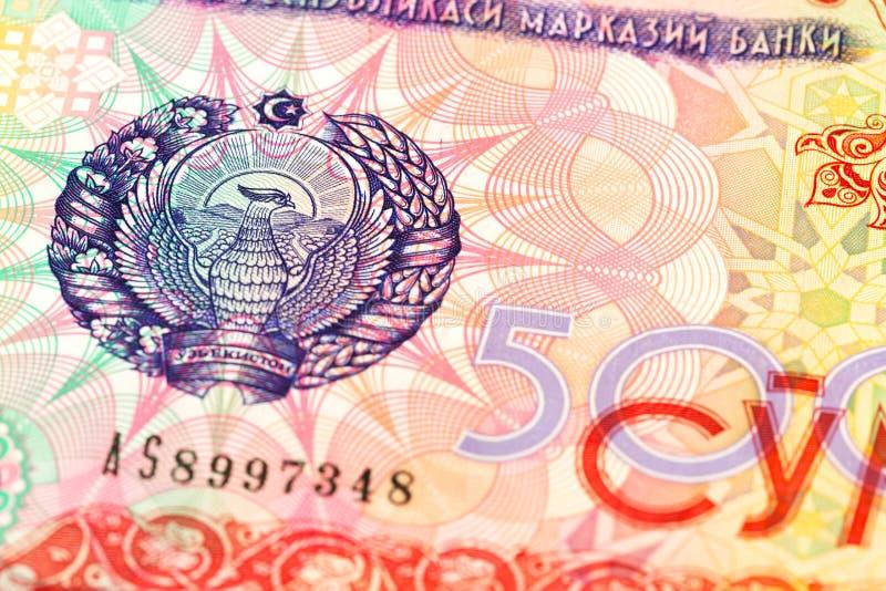 Dettaglio di un complemento della banconota del som di 500 usbek immagini stock libere da diritti