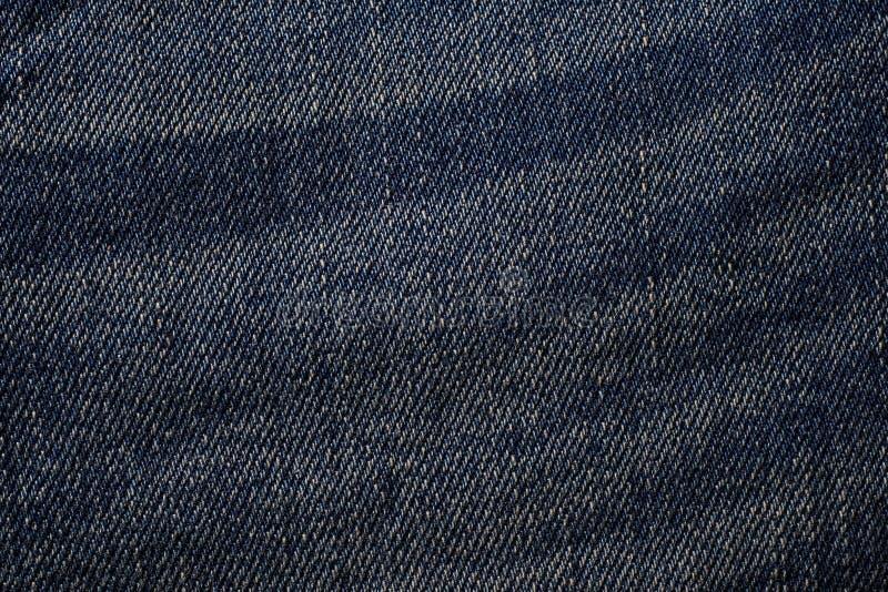 Dettaglio di un fondo strutturato d'annata delle blue jeans fotografia stock libera da diritti