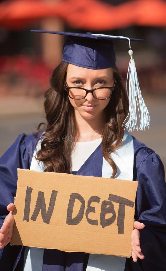 Deuda que lleva graduada imagen de archivo