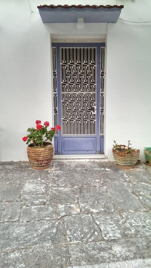 Deuropening van een huis in Geece stock fotografie