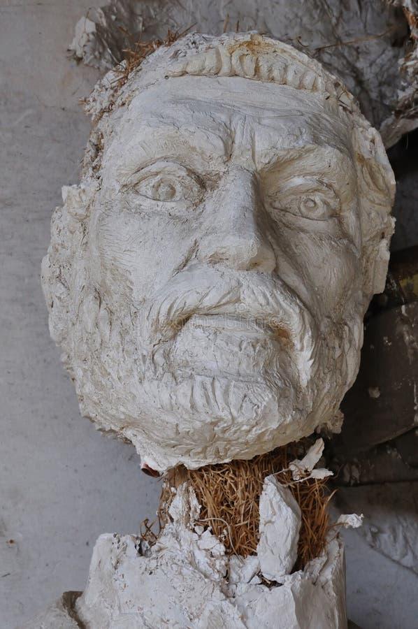 Deus antigo da cabeça quebrada da estátua fotos de stock