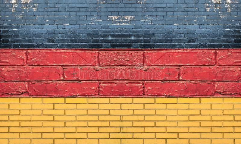 Deutsche Flagge von Deutschland machte mit Backsteinmauer lizenzfreie stockbilder