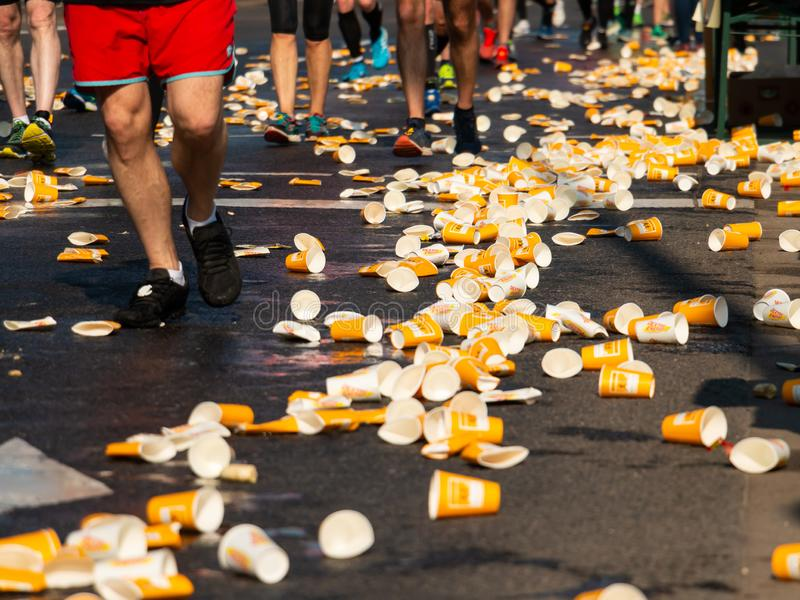 Deutsche Post Marathon Bonn, Germany, 7 April 2019. Street littered with plastic cups. stock image