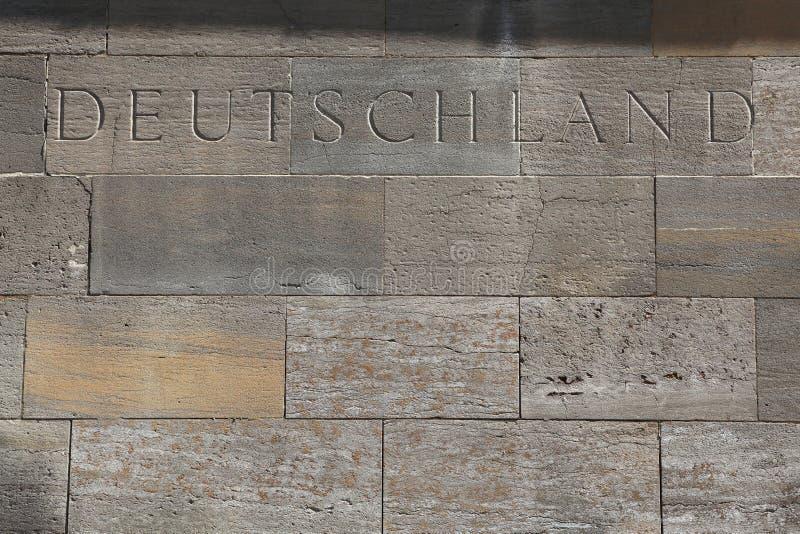 Deutschland (Duitsland) Word in steenblokken dat wordt gesneden royalty-vrije stock afbeeldingen