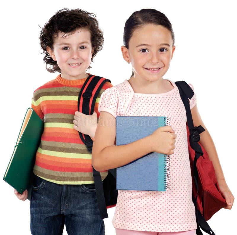 Deux étudiants d'enfants retournant à l'école photo stock