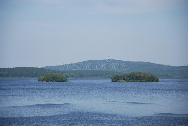 Deux îles dans l'eau images libres de droits
