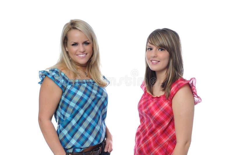 Deux amis posant ensemble photos stock