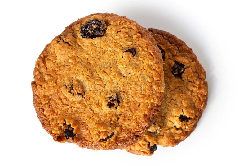 Deux avoine et biscuits ronds de raisin sec d'isolement sur le blanc d'en haut photographie stock libre de droits