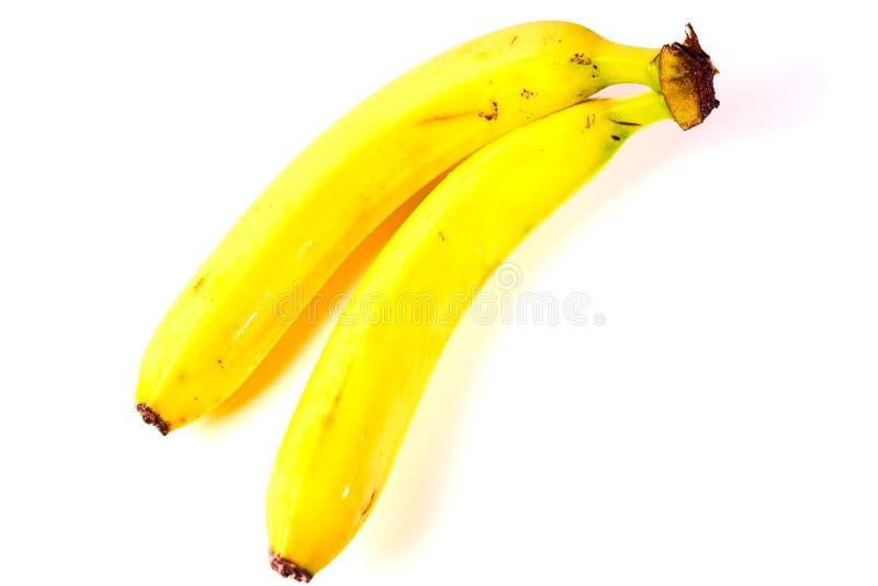 Deux bananes mûres d'isolement sur le fond blanc photo stock