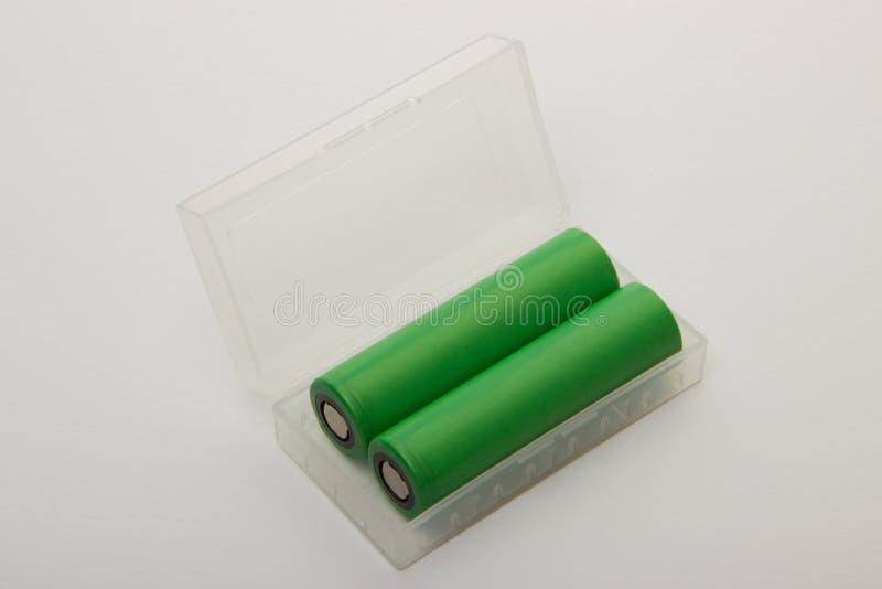 Download Deux Batteries Pour Les Cigarettes électroniques Sur Un Fond Blanc Photo stock - Image du matériel, liquide: 76079276
