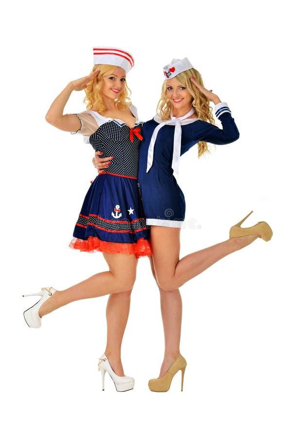 Deux belles femmes blondes dans des costumes de carnaval photos libres de droits