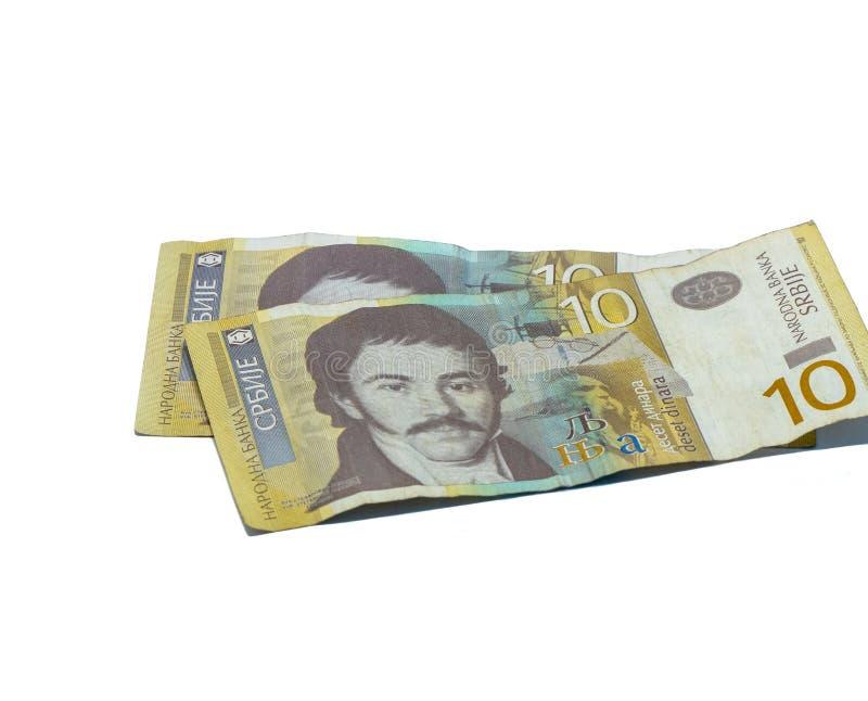Deux billets de banque en valeur 10 dinars serbes avec un portrait d'un linguiste Vuk Karadzic d'isolement sur un fond blanc photos libres de droits