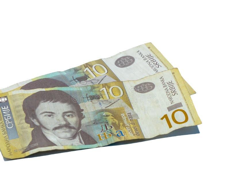 Deux billets de banque en valeur 10 dinars serbes avec un portrait d'un linguiste Vuk Karadzic sur un fond blanc image libre de droits