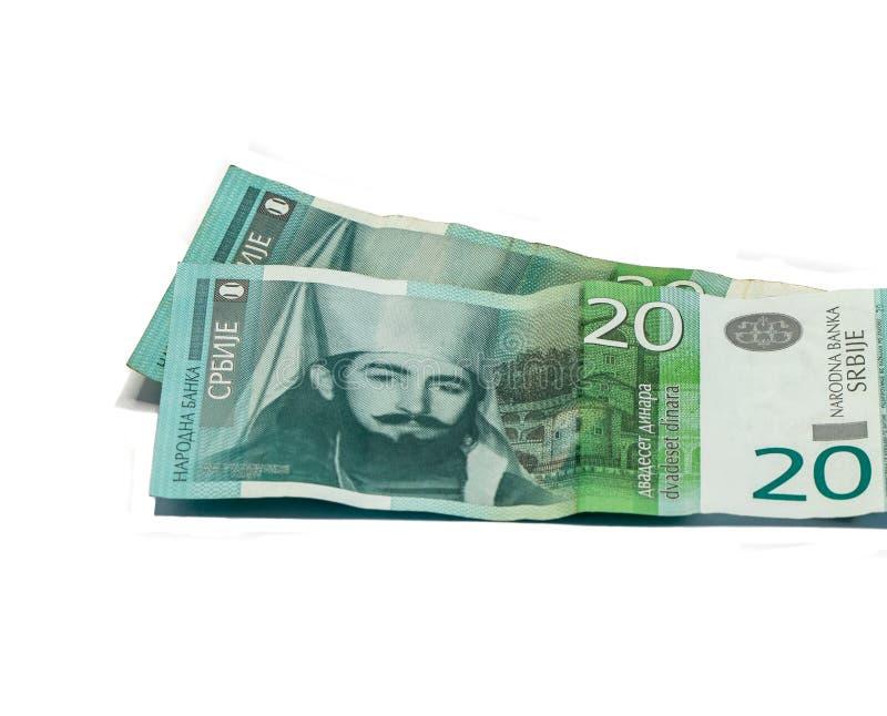 Deux billets de banque en valeur 20 dinars serbes avec un portrait de la règle de Monténégro Peter II Petrovich d'isolement sur l photo libre de droits