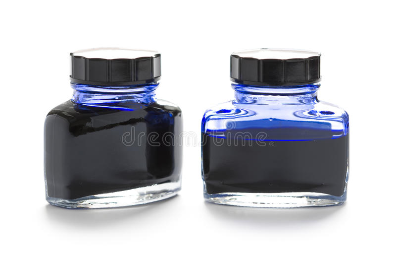 Deux bouteilles d'encre bleue photographie stock libre de droits