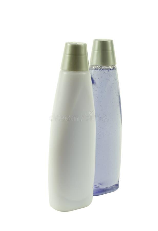 Deux bouteilles de shampooing bleu ; Vue d'angle images libres de droits