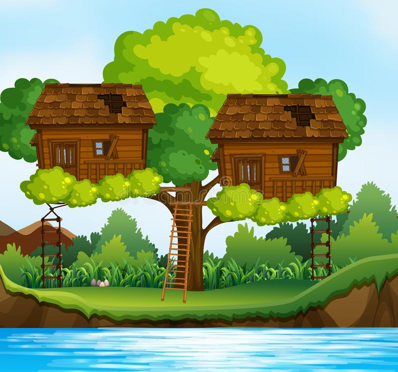 Deux cabanes dans un arbre sur l'arbre par la rivière illustration stock