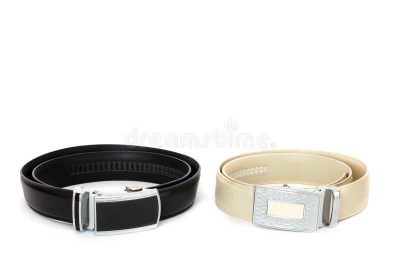 Deux ceintures en cuir sur un fond blanc image stock