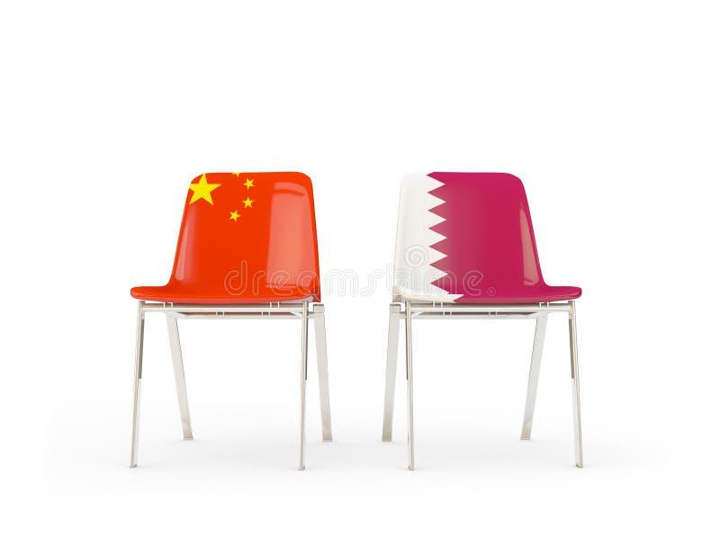 Deux chaises avec des drapeaux de la Chine et du Qatar illustration libre de droits