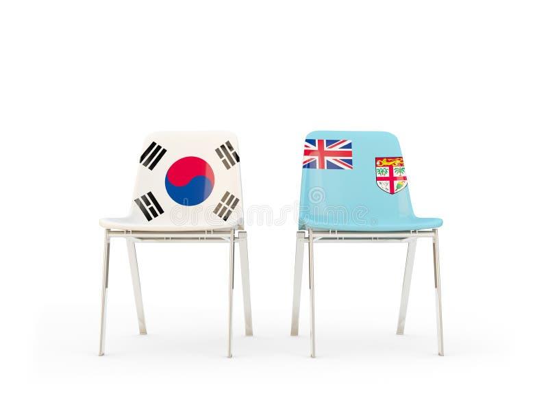 Deux chaises avec des drapeaux de la Corée du Sud et du Fiji d'isolement sur le blanc illustration libre de droits