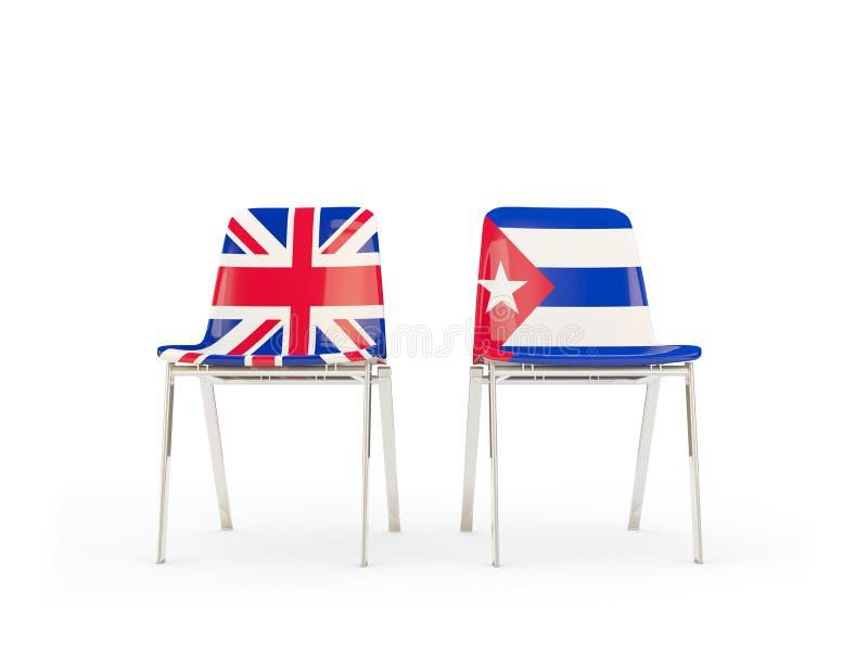 Deux chaises avec des drapeaux du Royaume-Uni et du Cuba d'isolement sur le blanc illustration stock