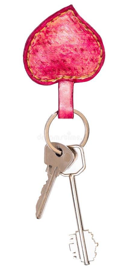 Deux clés de porte sur le gousset principal en forme de coeur en cuir rose photo stock