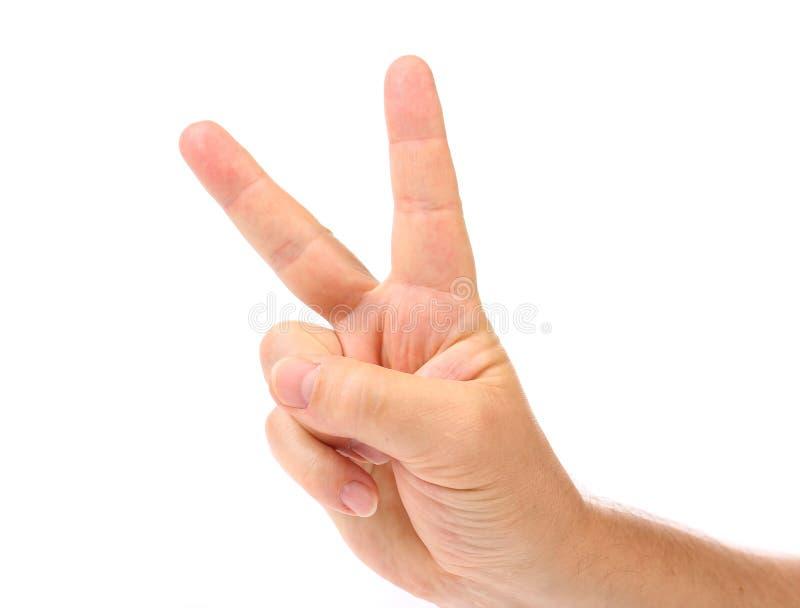 Deux doigts. La main de l'homme. image stock