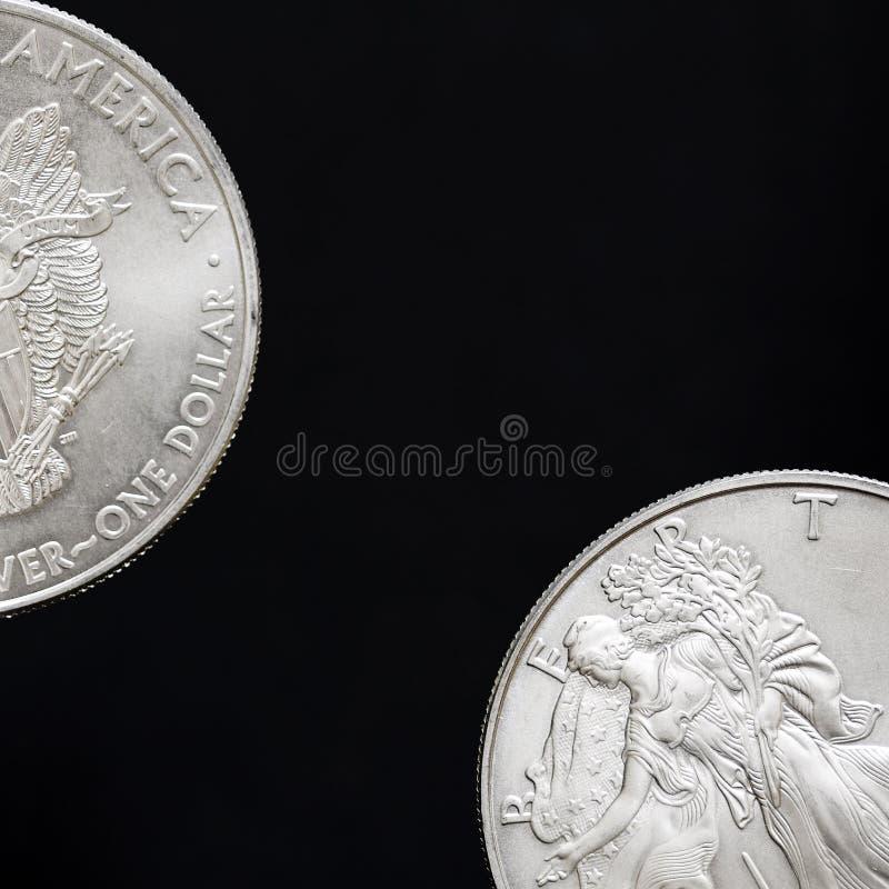 Deux dollars en argent, pièces de monnaie photographie stock libre de droits