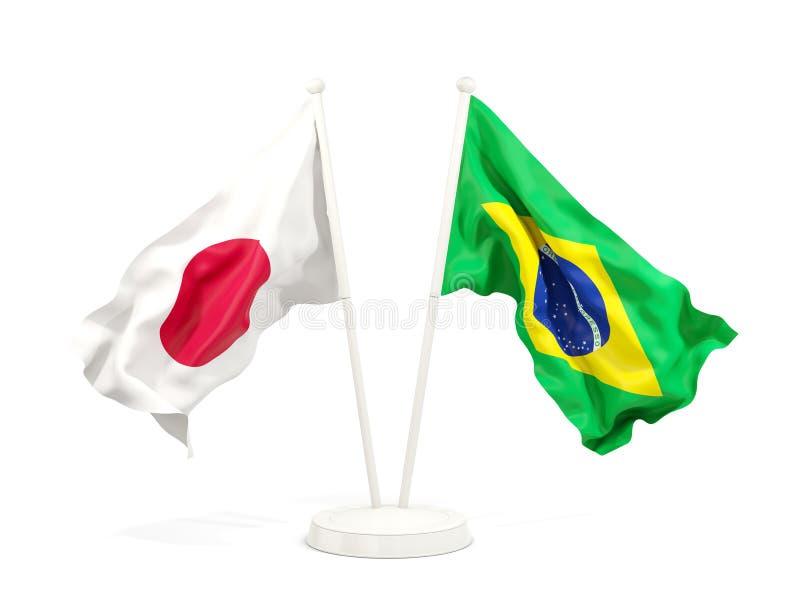 Deux drapeaux de ondulation du Japon et du Brésil illustration libre de droits