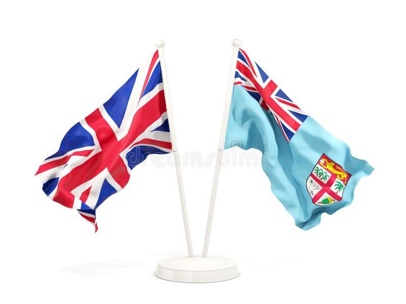 Deux drapeaux de ondulation du R-U et du Fiji d'isolement sur le blanc illustration stock