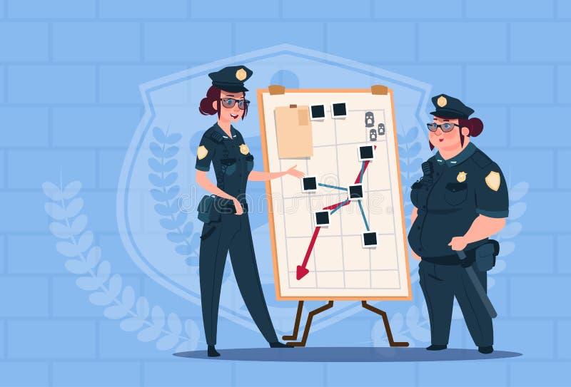 Deux femmes de police prévoyant l'action sur le conseil blanc portant les gardes uniformes de femelle sur le fond bleu de briques illustration libre de droits