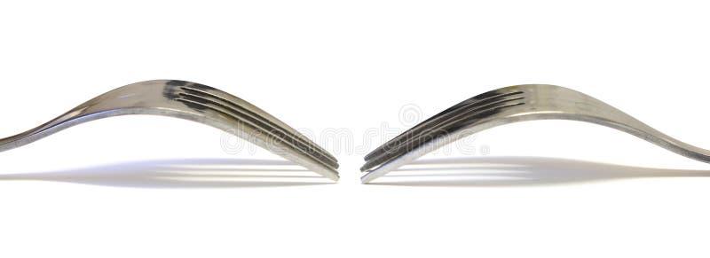 Deux Fourchettes Se Faisant Face Sur Le Blanc Photo libre de droits