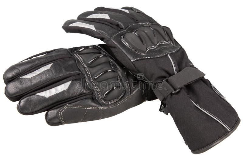 Deux gants noirs de moto à l'arrière-plan d'isolement blanc photo libre de droits