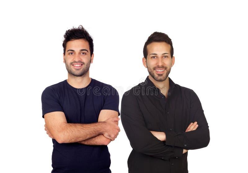 Deux garçons attirants dans le noir photographie stock libre de droits