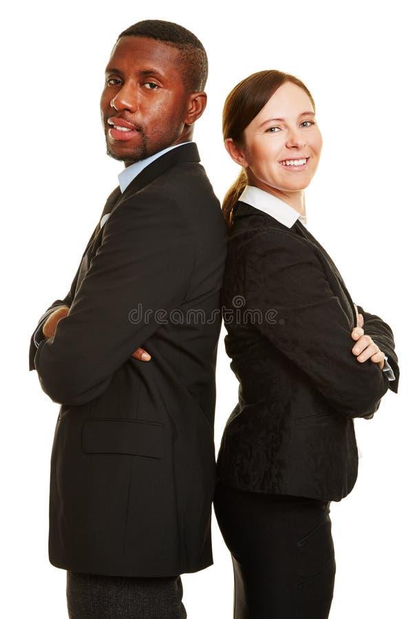 Deux gens d'affaires de nouveau au dos photographie stock libre de droits