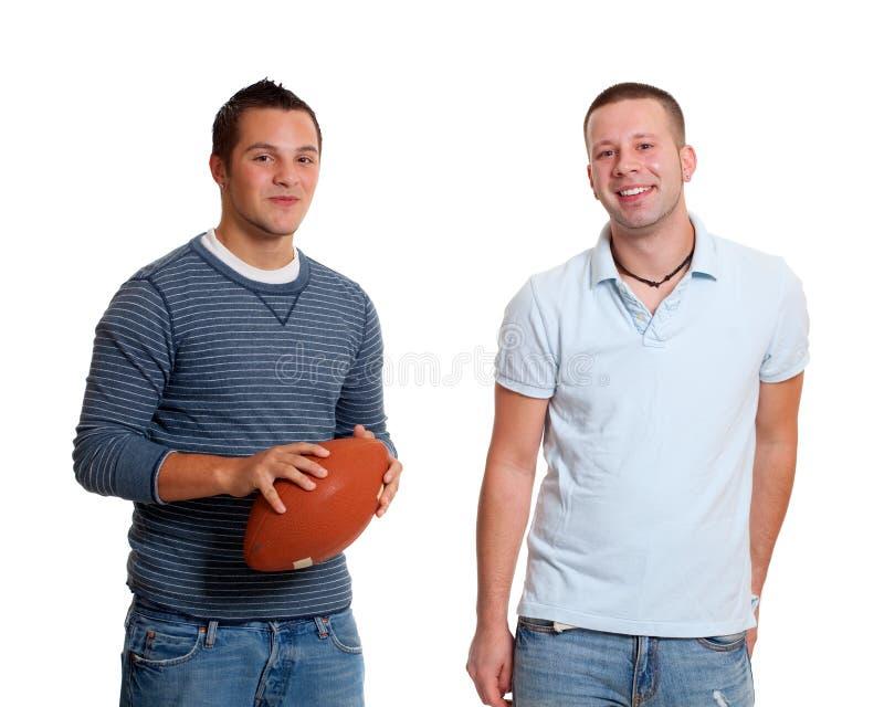 Deux hommes avec le football image stock