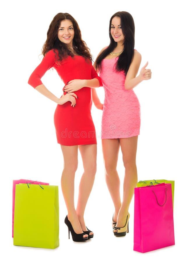 Deux jeunes filles avec des sacs images stock