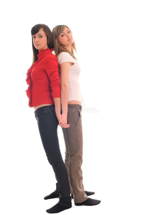 Deux jeunes filles d'isolement sur le blanc photo libre de droits