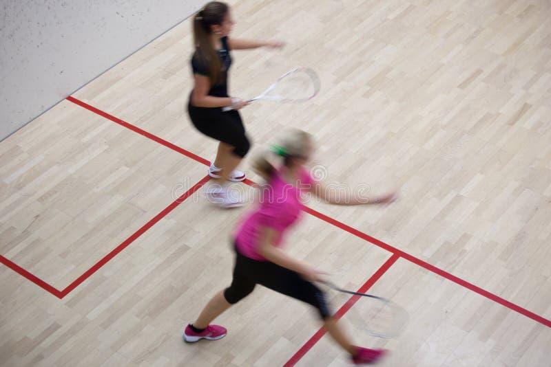 Deux joueurs féminins de courge photos stock