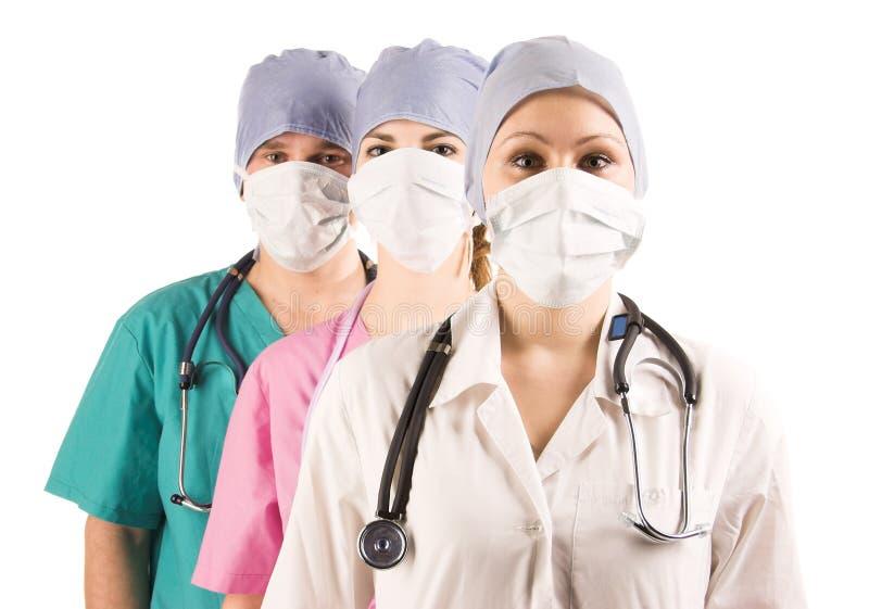 Deux médecins et infirmière images stock