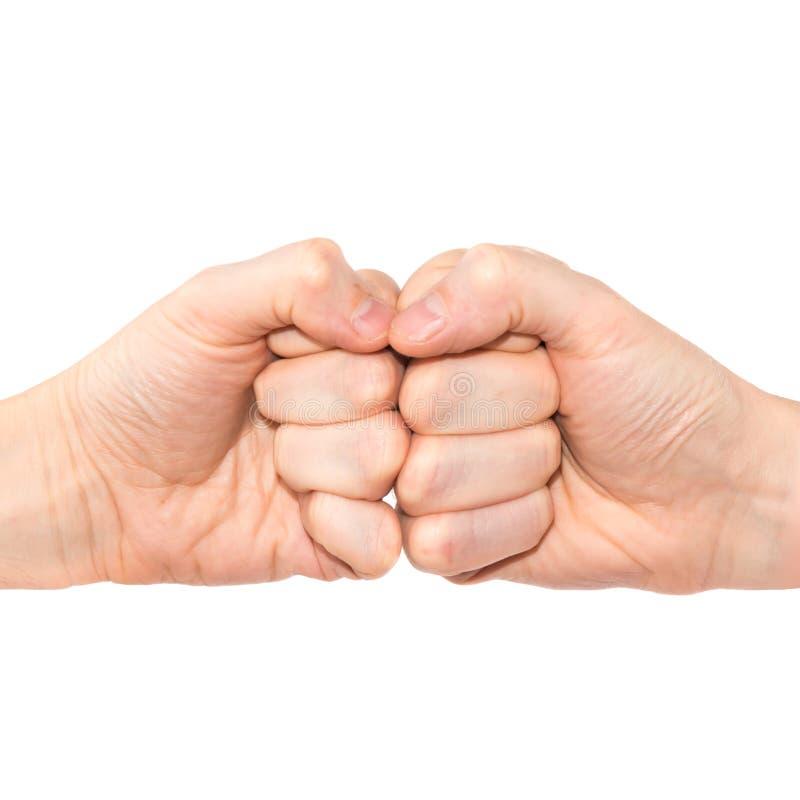 Deux mains avec des poings image stock