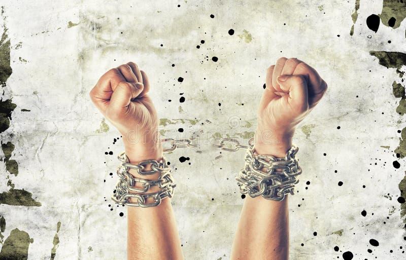 Deux mains dans les chaînes images stock