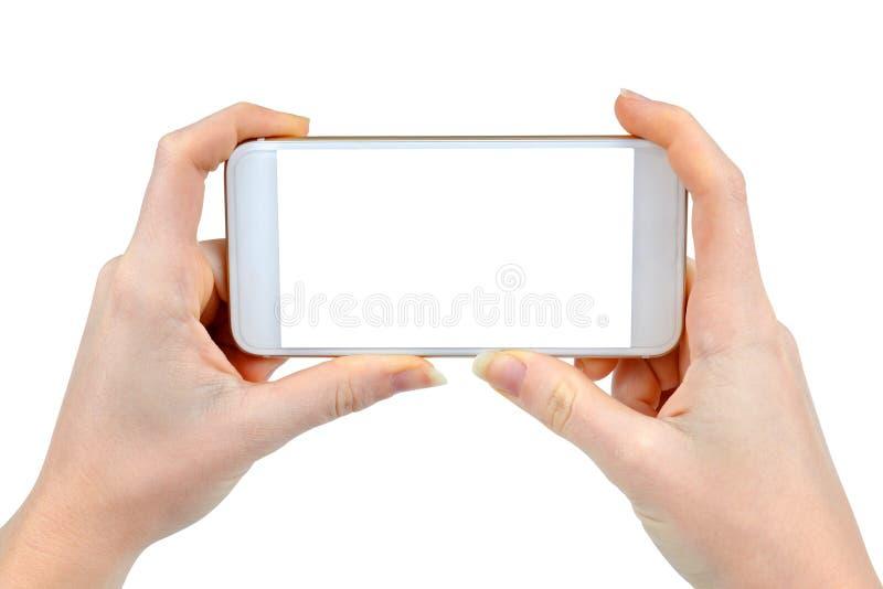 Deux mains de femme tenant le téléphone intelligent mobile images libres de droits
