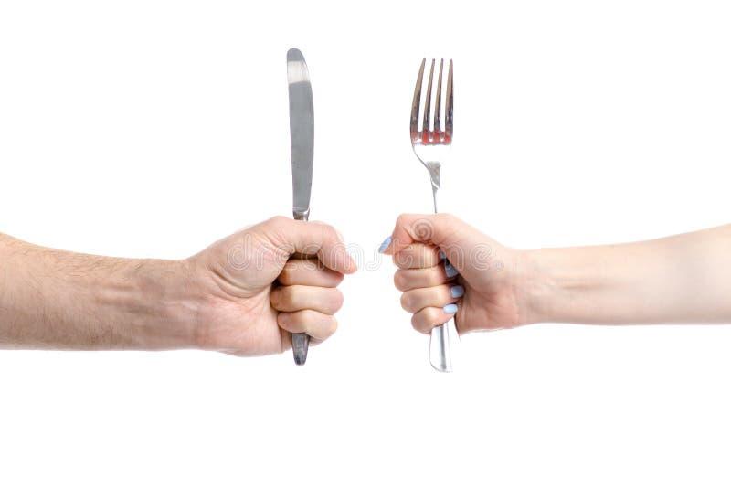 Deux mains retenant la fourchette et le couteau image stock