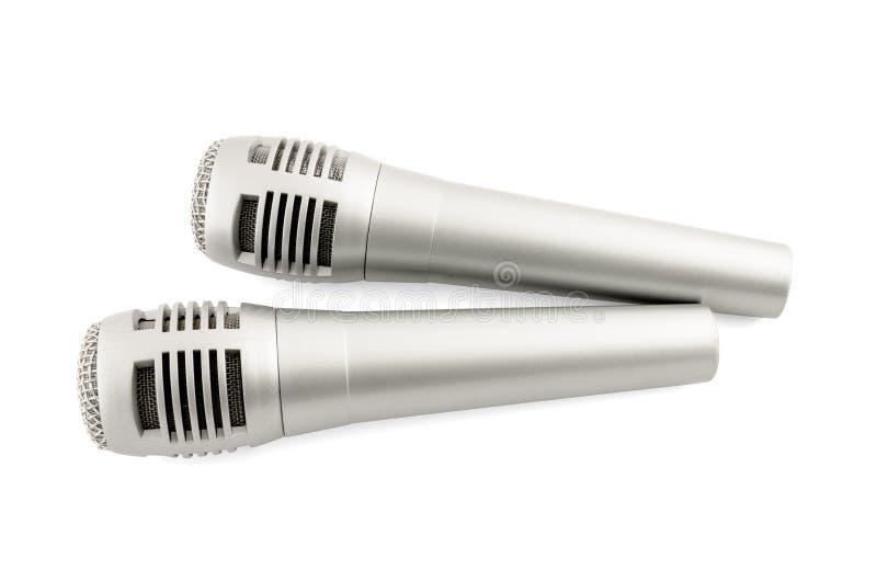 Deux microhones d'isolement sur le blanc photo stock