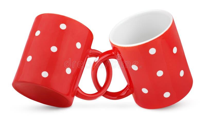 Deux ont accouplé les tasses rouges de point de polka photographie stock libre de droits