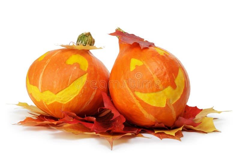 Deux potirons rayés drôles de Halloween images stock